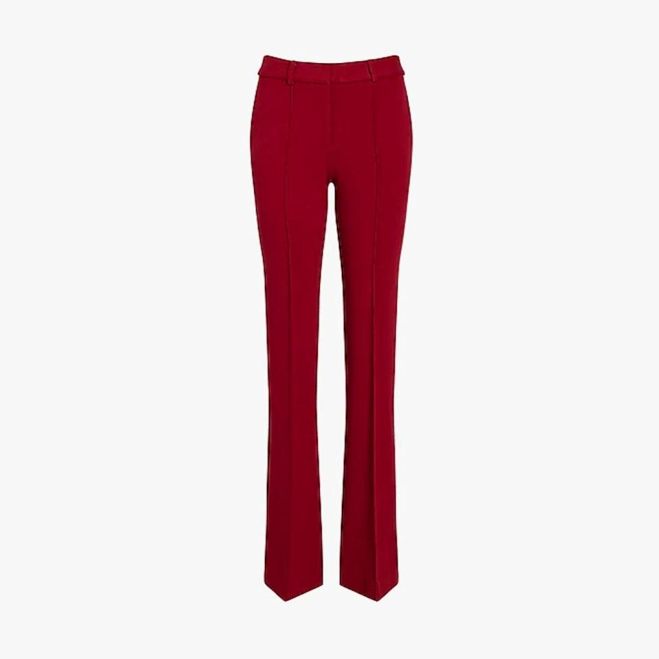 "$60, EXPRESS. <a href=""https://www.express.com/clothing/women/high-waisted-stretch-knit-flare-pant/pro/07441152/color/Bold%20Red/e/regular/?CID=SEO_GOO-SAG-F-Organic-Retail-00-000-Pants-US-Product-NA"" rel=""nofollow noopener"" target=""_blank"" data-ylk=""slk:Get it now!"" class=""link rapid-noclick-resp"">Get it now!</a>"