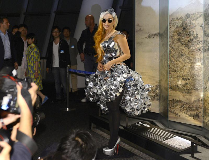 """Lady Gaga poses as she visits the Tokyo Sky Tree, the world's tallest freestanding broadcast structure that stands 634-meter (2,080 feet), in Tokyo Tuesday, May 15, 2012. Lady Gaga might have to cancel her sold-out show in Indonesia because Islamic hard-liners and conservative lawmakers objected. National police spokesman Boy Rafli Amar said the permit was denied for the June 3, 2012, """"Born This Way"""" concert that was to be the biggest show on her Asian tour. (AP Photo/Kyodo News) JAPAN OUT, MANDATORY CREDIT, NO LICENSING IN CHINA, HONG KONG, JAPAN, SOUTH KOREA AND FRANCE"""