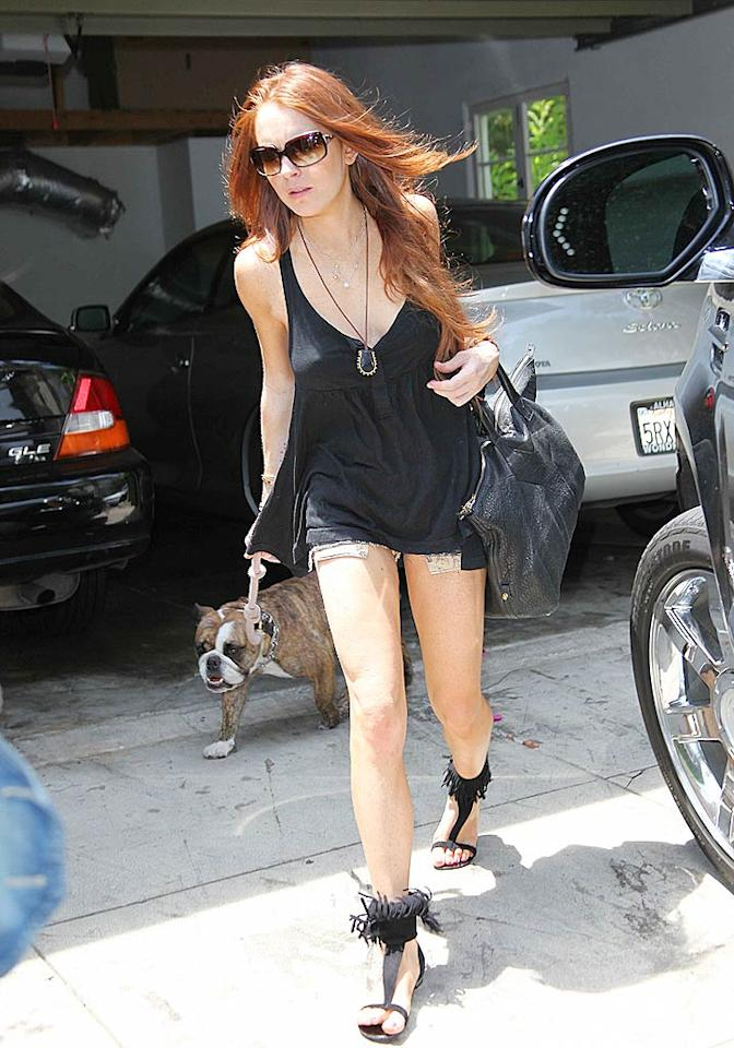 "Lindsay Lohan has fun with fringe. <a href=""http://www.splashnewsonline.com/"" target=""new"">Splash News</a> - July 24, 2009"