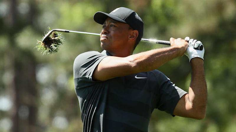 Woods only four back as Spieth troubles bunch up Masters leaderboard