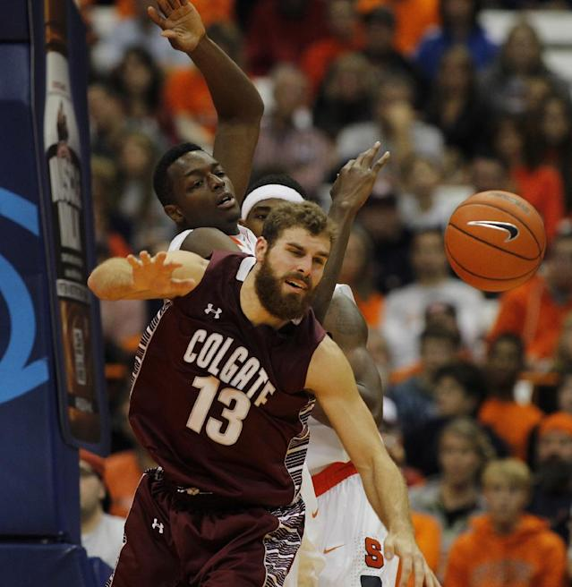 Colgate's Murphy Burnatowski, front, battles for a rebound against Syracuse's Jerami Grant, middle, and C.J. Fair, back, in the second half of an NCAA college basketball game in Syracuse, N.Y., Saturday, Nov. 16, 2013. Syracuse won 69-50. (AP Photo/Nick Lisi)