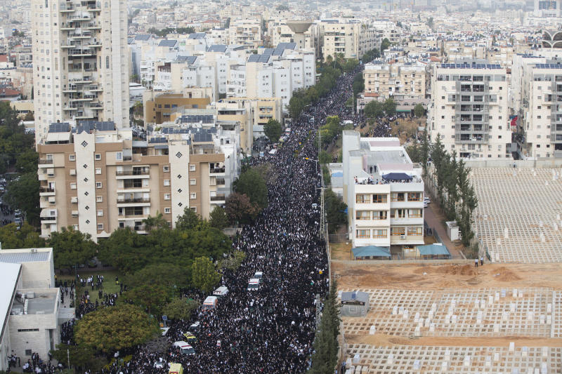 Thousand gather at the funeral Rabbi Aharon Leib Shteinman in the central Israeli city of Bnei Brak, Tuesday, Dec. 12, 2017. Shteinman , the spiritual leader of Israel's non-Hassidic ultra-Orthodox Jews of European descent and one of the country's most influential and powerful rabbis, died on Tuesday. He was 104. (AP Photo/Oded Balilty)