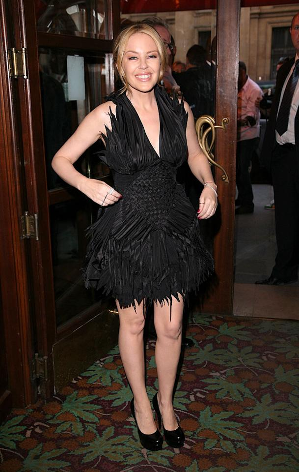 "Australian pop icon Kylie Minogue was the center of attention at amfAR's Inspiration Night auction at Maxim's in Paris. The petite star was utterly fab in a feather-embellished Jean Paul Gaultier Spring 2010 Couture mini. Julien M. Hekimian/<a href=""http://www.gettyimages.com/"" target=""new"">GettyImages.com</a> - June 25, 2010"