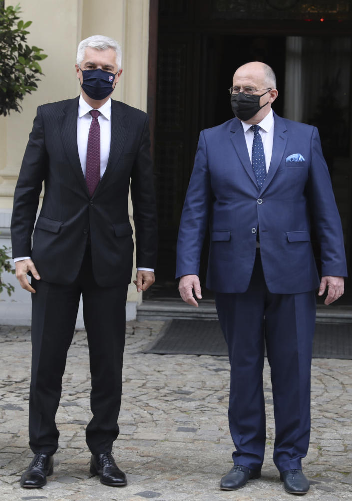 Poland's Foreign Minister Zbigniew Rau,right, gestures toward Slovak Foreign Minister Ivan Korcok, ahead of a meeting with regional counterparts in Lodz, Poland, Friday, May 14, 2021.(AP Photo/Czarek Sokolowski)