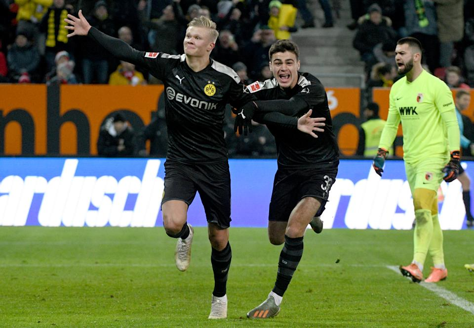 Erling Haaland (left) scored three times in 20 minutes and U.S. youth international Gio Reyna also made his Borussia Dortmund debut in Saturday's victory. (Photo by Stefan Puchner/picture alliance via Getty Images)