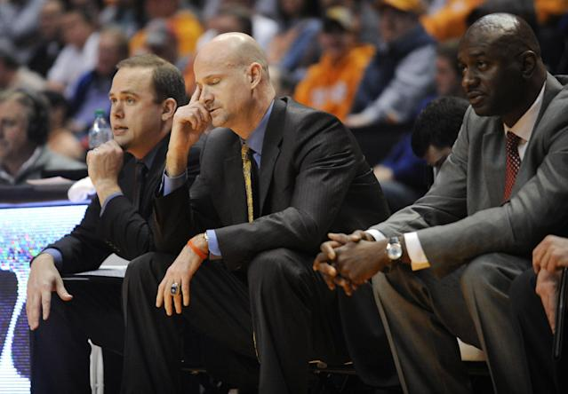 Mississippi coach Andy Kennedy, center, closes his eyes near the end of the first half against Tennessee in an NCAA college basketball game Wednesday, Jan. 29, 2014, in Knoxville, Tenn. (AP Photo/Knoxville News Sentinel, Adam Lau)