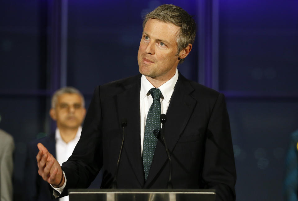 Zac Goldsmith, Conservative Party candidate, speaks in front of election winner Sadiq Khan, Labour Party candidate, after the London mayoral elections, at City Hall in London, Saturday, May 7, 2016. (AP Photo/Kirsty Wigglesworth)