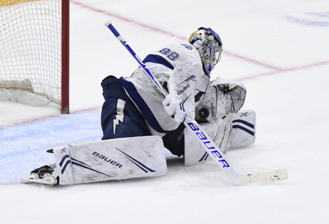 Tampa Bay Lightning goaltender Andrei Vasilevskiy makes a save in overtime against the New York Islanders during an NHL hockey game Friday, Feb. 1, 2019, in Uniondale, N.Y. The Lightning won in a shootout 1-0. (AP Photo/Kathleen Malone-Van Dyke)