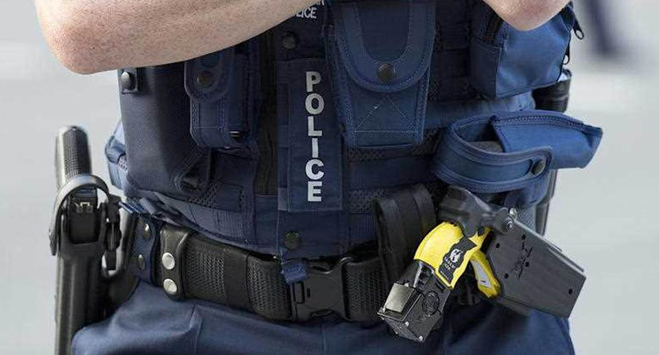 Stock photograph of a Queensland Police Officer wearing a Taser and a hand gun in the Brisbane CBD.