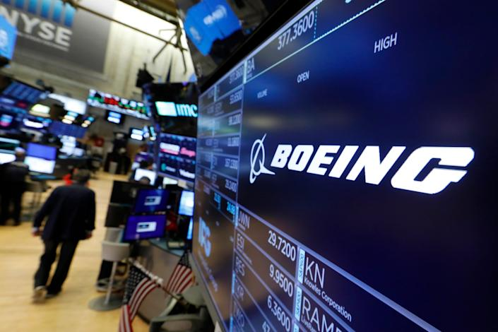 The logo for Boeing appears above a trading post on the floor of the New York Stock Exchange, Monday, July 22, 2019. The company is scheduled to release its second quarter earnings Wednesday. (AP Photo/Richard Drew)
