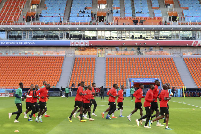 Senegal players warm up during the official training on the eve of the group H match between Japan and Senegal at the 2018 soccer World Cup in the Yekaterinburg Arena in Yekaterinburg, Russia, Saturday, June 23, 2018. (AP Photo/Eugene Hoshiko)