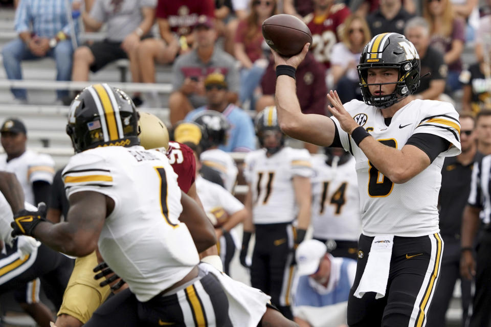 Missouri quarterback Connor Bazelak (8) passes to Tyler Badie (1) during the first half of an NCAA college football game against Boston College, Saturday, Sept. 25, 2021, in Boston. (AP Photo/Mary Schwalm)