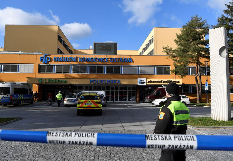 Police officers walks outside the University Hospital, which was a site of a shooting, in Ostrava