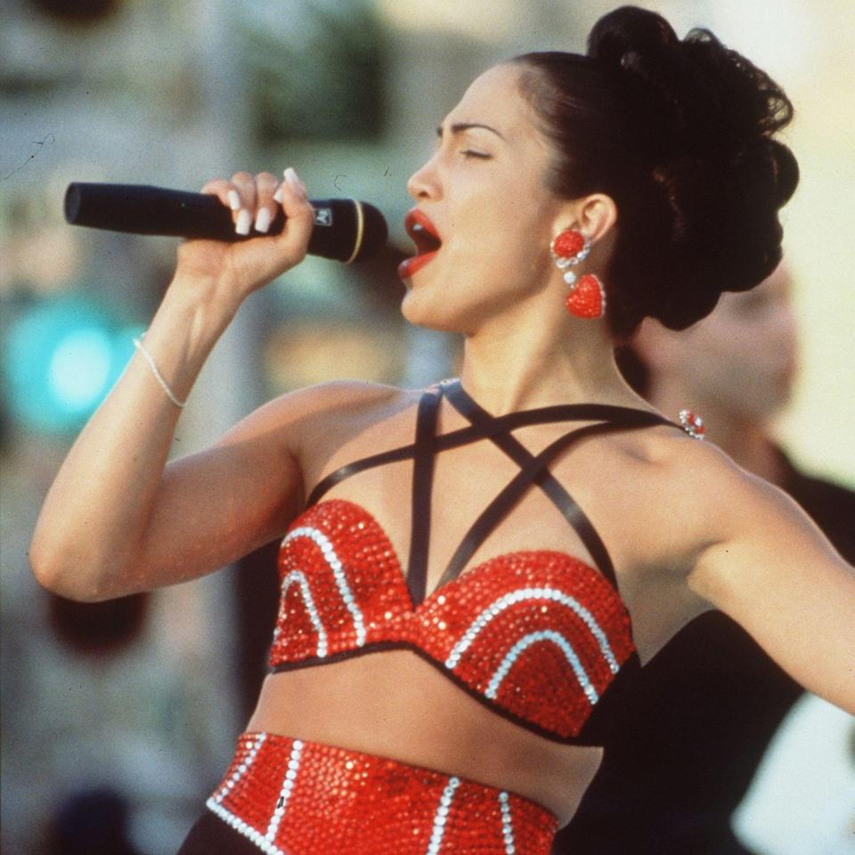 """<p>The soundtrack for 1997's <em>Selena</em> only flirts with the true essence of Selena Quintanilla-Pérez, the Queen of Tejano Music and the beloved 23-year-old singer who was tragically ripped from this earth beyond way too soon. Played by Jennifer Lopez on the big screen, Selena crossed over into pop with mega hits including """"<a href=""""https://www.youtube.com/watch?v=sBFBbqyysGU"""" rel=""""nofollow noopener"""" target=""""_blank"""" data-ylk=""""slk:Dreaming of You"""" class=""""link rapid-noclick-resp"""">Dreaming of You</a>"""" and """"<a href=""""https://www.youtube.com/watch?v=hKlIpVnc8Gk"""" rel=""""nofollow noopener"""" target=""""_blank"""" data-ylk=""""slk:I Could Fall in Love"""" class=""""link rapid-noclick-resp"""">I Could Fall in Love</a>."""" Those nostalgic gems are here, and more, but the only way to truly appreciate the superstar is to follow this English language-heavy soundtrack with hits from Selena's <a href=""""https://www.billboard.com/articles/columns/latin/9344829/selena-hot-latin-songs-hits"""" rel=""""nofollow noopener"""" target=""""_blank"""" data-ylk=""""slk:solid-gold Latin discography"""" class=""""link rapid-noclick-resp"""">solid-gold Latin discography</a>.</p><p><a class=""""link rapid-noclick-resp"""" href=""""https://www.amazon.com/Selena-Jennifer-Lopez/dp/B001AWDF18?tag=syn-yahoo-20&ascsubtag=%5Bartid%7C10056.g.32872244%5Bsrc%7Cyahoo-us"""" rel=""""nofollow noopener"""" target=""""_blank"""" data-ylk=""""slk:Watch and Listen"""">Watch and Listen</a></p>"""