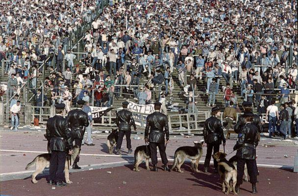 PHOTO: Belgium policemen with dogs face Italian fans, on May 29, 1985 in Heysel stadium in Brussels (AFP via Getty Images, FILE)