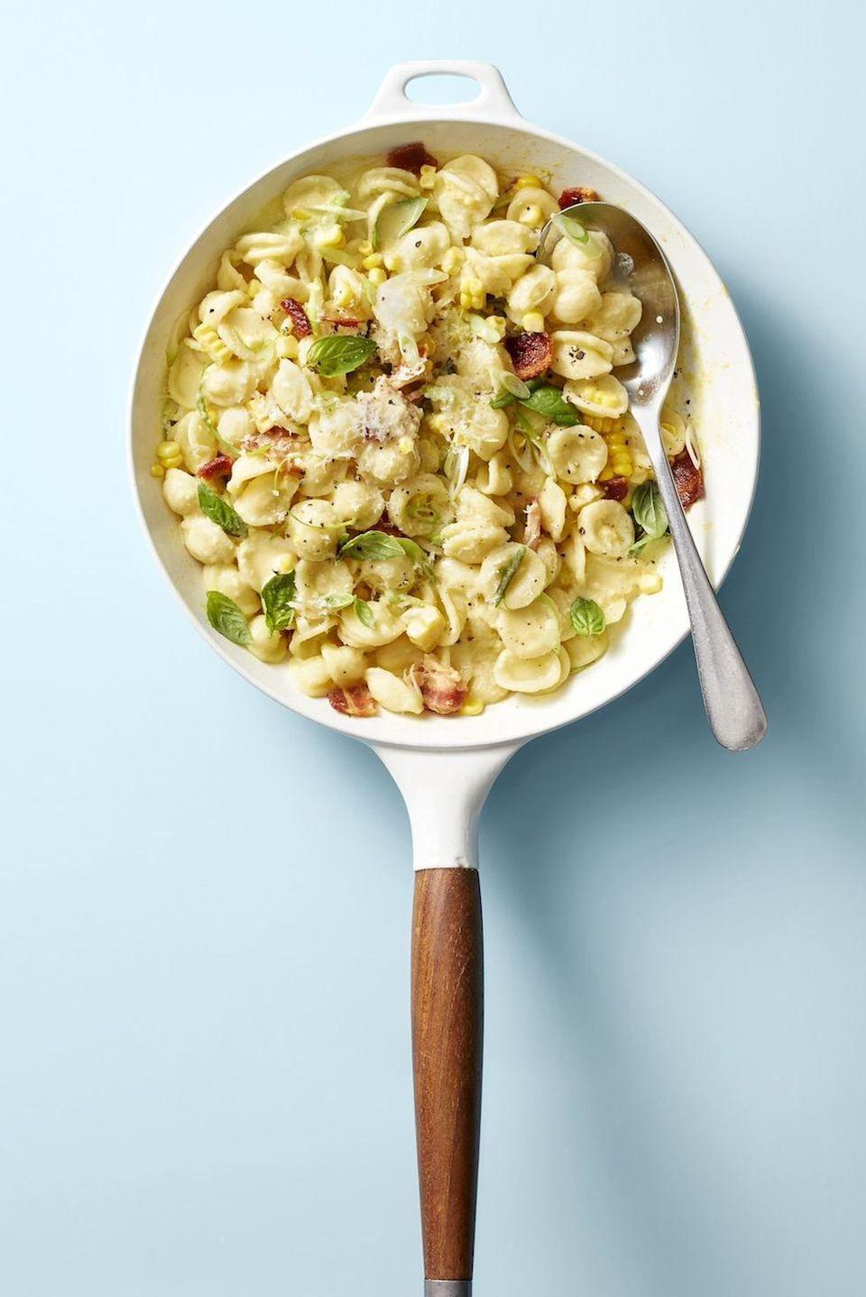 """<p>Fresh corn adds sweetness (and some veggies) to this tasty <a href=""""https://www.goodhousekeeping.com/food-recipes/easy/g2341/pasta-recipes-with-5-ingredients/"""" rel=""""nofollow noopener"""" target=""""_blank"""" data-ylk=""""slk:family-friendly pasta"""" class=""""link rapid-noclick-resp"""">family-friendly pasta</a>.</p><p><em><a href=""""https://www.goodhousekeeping.com/food-recipes/easy/a28196797/creamy-corn-pasta-with-bacon-and-scallions-recipe/"""" rel=""""nofollow noopener"""" target=""""_blank"""" data-ylk=""""slk:Get the recipe for Creamy Corn Pasta with Bacon and Scallions »"""" class=""""link rapid-noclick-resp"""">Get the recipe for Creamy Corn Pasta with Bacon and Scallions »</a></em></p>"""