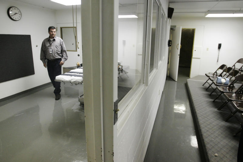 "FILE - In this April 15, 2008, file photo Terry Crenshaw, wardens assistant at the Oklahoma State Penitentiary, walks past the gurney in the execution chamber at left, in McAlester, Okla. U.S. District Judge Stephen Friot will conduct a preliminary injunction hearing Friday, Nov. 19, 2010, in Oklahoma City over the use of a new drug used in the lethal injection procedure. Death row inmates Jeffrey David Matthews and John David Duty both are challenging the use of the new drug, called pentobarbital that is used in animal euthanasia, alleging an impending violation of their constitutional rights to be free from ""cruel and unusual punishment.""  (AP Photo, File)"