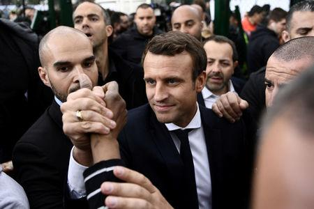 Emmanuel Macron, head of the political movement En Marche !, or Onwards !, and candidate for the 2017 presidential election, kicks a soccer ball during a campaign visit in Sarcelles