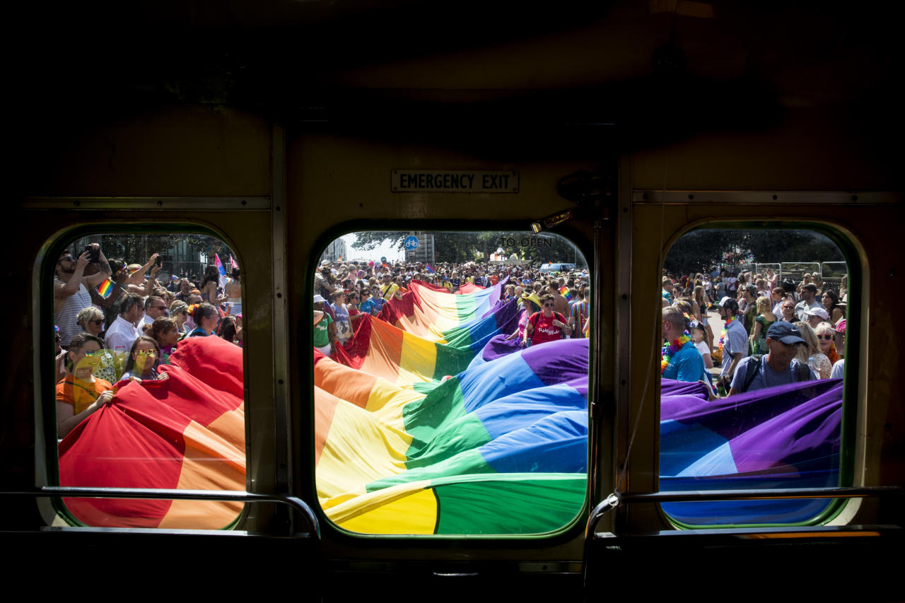 <p>A giant rainbow Pride flag is carried through the centre of Brighton during Brighton Pride 2018 (Getty Images) </p>