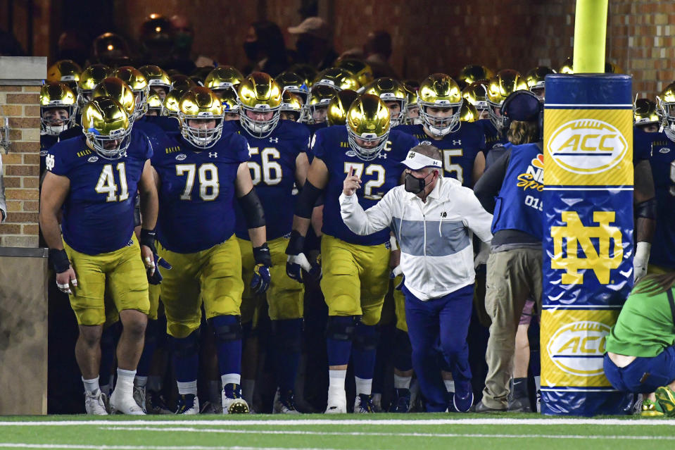 Notre Dame coach Brian Kelly leads the team out of the tunnel for an NCAA college football game against Clemson on Saturday, Nov. 7, 2020, in South Bend, Ind. (Matt Cashore/Pool Photo via AP)