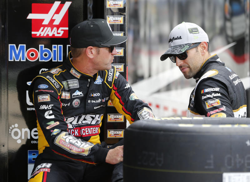 Clint Bowyer (L) is getting Aric Almirola's crew chief in 2020. Almirola is getting Bowyer's crew chief. (Photo by Brian Lawdermilk/Getty Images)