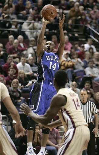 Duke's Rasheed Sulaimon shoots and scores over the defense of Florida State's Robert Gilchrist in the first half of an NCAA college basketball game Saturday, Feb. 2, 2013, in Tallahassee, Fla. Duke won 79-60. (AP Photo/Steve Cannon)