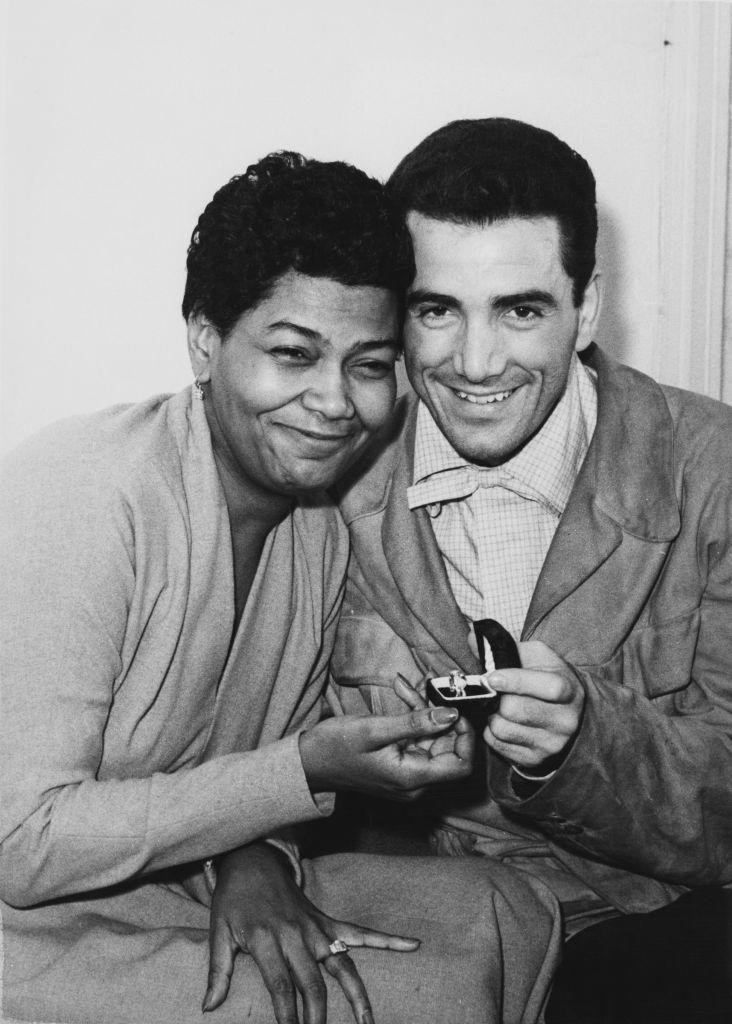 """<p>American singer Pearl Bailey gives fans a glimpse at her and Jazz musician Louie Bellson's wedding bands as they prepared for their upcoming ceremony in London in 1952. Bailey and Bellson got married <a href=""""https://medium.com/@MXDrelationship/fascinating-interracial-marriages-in-history-61fecd889bac"""" rel=""""nofollow noopener"""" target=""""_blank"""" data-ylk=""""slk:only four days after they met"""" class=""""link rapid-noclick-resp"""">only four days after they met</a> and were together until Bailey's death in 1990. </p>"""