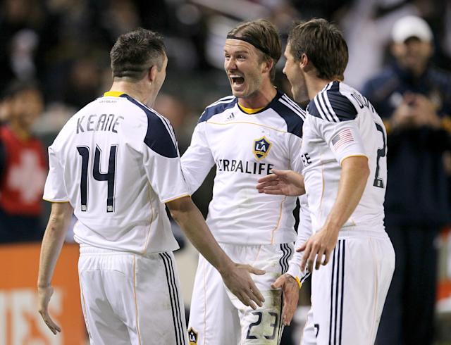 CARSON, CA - NOVEMBER 06: Robbie Keane #14 of the Los Angeles Galaxy celebrates with David Beckham #23 and Todd Dunivant #2 after Keane scored the Galaxy's third goal against Real Salt Lake in the MLS Western Conference Championship at The Home Depot Center on November 6, 2011 in Carson, California. The Galaxy won 3-1 to advance to the MLS Cup. (Photo by Stephen Dunn/Getty Images)