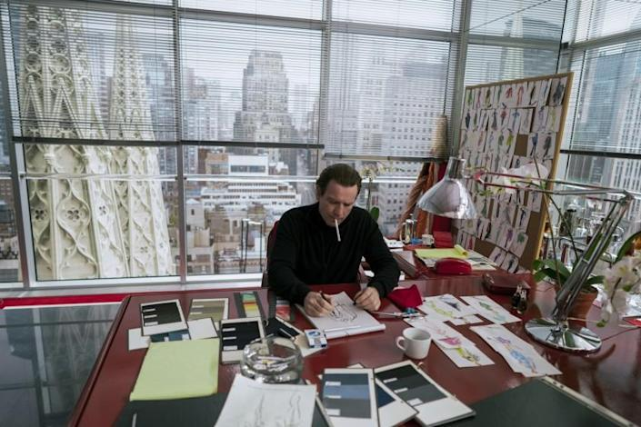 A fashion designer in his office high above New York
