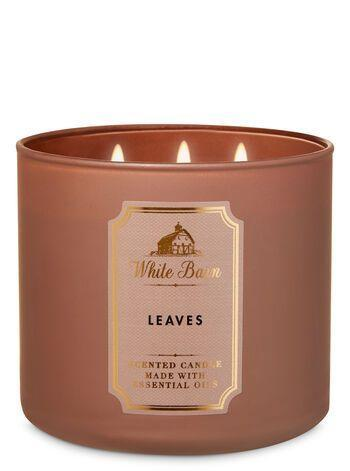 """<p><strong>Bath & Body Works</strong></p><p>bathandbodyworks.com</p><p><strong>$14.50</strong></p><p><a href=""""https://www.bathandbodyworks.com/p/leaves-3-wick-candle-026154797.html"""" rel=""""nofollow noopener"""" target=""""_blank"""" data-ylk=""""slk:Shop Now"""" class=""""link rapid-noclick-resp"""">Shop Now</a></p><p>Clove spice, red apple, and essential oils make up this super fall candle that's meant to smell like autumnal leaves. </p>"""
