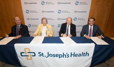 St. Joseph's Health and Hackensack Meridian Health announce clinical and strategic partnership. Pictured from left to right: Kevin J. Slavin, president and chief executive officer at St. Joseph's Health; Sister Marilyn Thie, SC, chair of the Board of Trustees at St. Joseph's Health; Gordon Litwin, Esq., chair of the Hackensack Meridian Health Board of Trustees and Robert C. Garrett, FACHE, CEO of Hackensack Meridian Health.