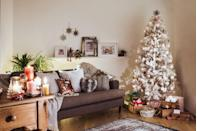 <p>Pair your white Christmas tree with all-metallic ornaments for a tree that will truly glitter with every reflection of light. </p>