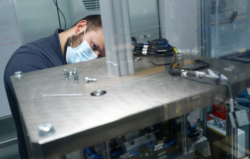 An employee works on a production line at HAHN Automation company in Rheinboellen