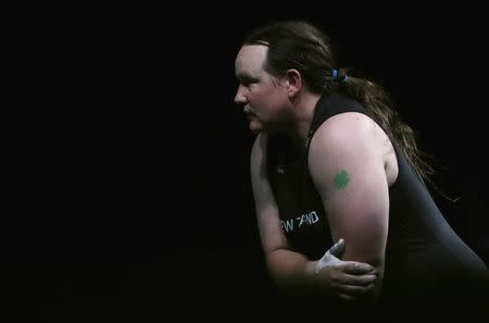 Weightlifting - Gold Coast 2018 Commonwealth Games - Women's +90kg - Final - Carrara Sports Arena 1 - Gold Coast, Australia - April 9, 2018. Laurel Hubbard of New Zealand holds her arm before pulling out with injury. REUTERS/Paul Childs