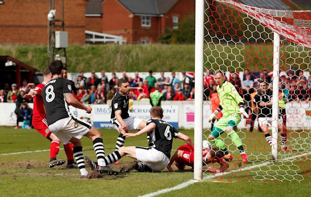 "Soccer Football - League Two - Accrington Stanley v Lincoln City - Wham Stadium, Accrington, Britain - April 28, 2018 Accrington Stanley's Jordan Clark (on goal line) scores their first goal Action Images/Andrew Boyers EDITORIAL USE ONLY. No use with unauthorized audio, video, data, fixture lists, club/league logos or ""live"" services. Online in-match use limited to 75 images, no video emulation. No use in betting, games or single club/league/player publications. Please contact your account representative for further details."
