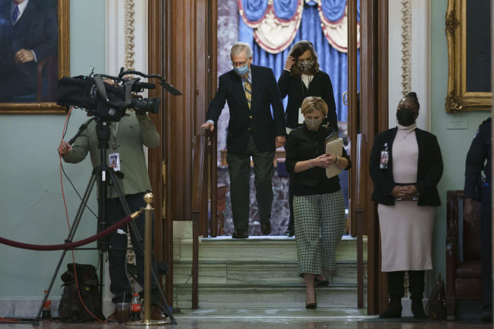 """Senate Minority Leader Mitch McConnell, R-Ky., leaves the chamber after the Senate voted not guilty in the impeachment trial of former President Donald Trump on the charge of inciting the January 6 attack on the Congress by a mob of his supporters, at the Capitol in Washington, Saturday, Feb. 13, 2021. After voting to acquit Trump of the impeachment charge, McConnell said there is still """"no question"""" that Trump was """"practically and morally responsible for provoking"""" the deadly attack on the U.S. Capitol. (AP Photo/J. Scott Applewhite)"""