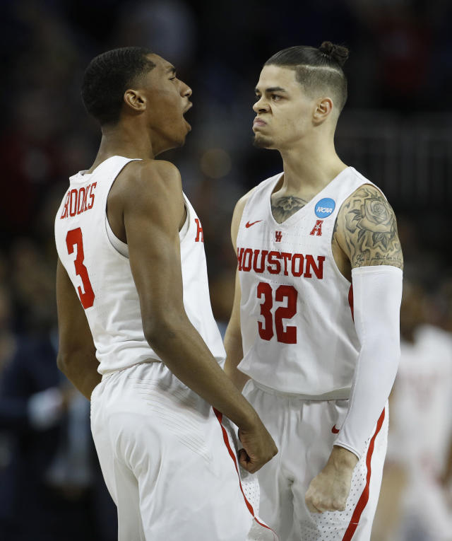 Houston guard Rob Gray, right, celebrates with teammate Armoni Brooks, left, after making the game-winning basket in a NCAA men's college basketball tournament first-round game against San Diego State Thursday, March 15, 2018, in Wichita, Kan. Houston won 67-65. (AP Photo/Charlie Riedel)