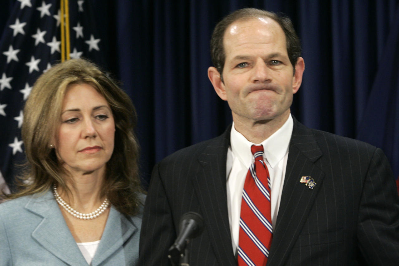 "FILE - In this March 10, 2008 file photo, then New York State Gov. Eliot Spitzer is joined by his wife Silda as he makes a statement to reporters during a news conference in New York. Spitzer's fall from grace is documented in the Alex Gibney documentary, ""Client 9."""