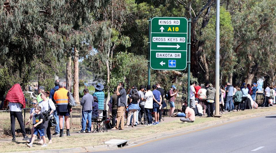 A long line of people are seen queuing at the Covid-19 testing site at Parafield Airport in Adelaide.