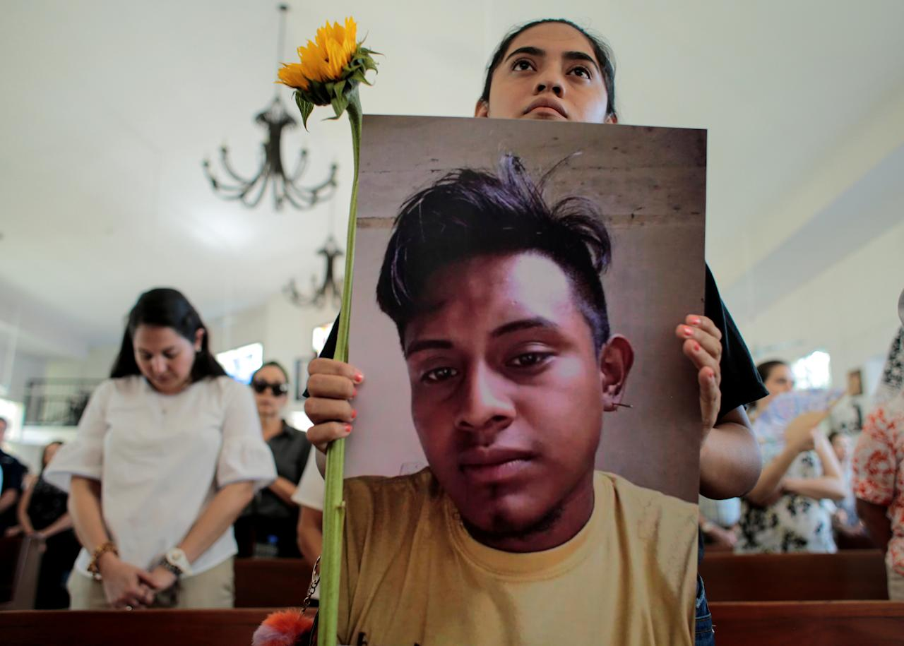 A relative holds a picture of Francisco Flores during a religious service to commemorate the first anniversary of the death of protesters who died during the attack on the Divine Mercy Church while participating in a protest against Nicaraguan President Daniel Ortega's government in Managua, Nicaragua July 13, 2019. REUTERS/Oswaldo Rivas     TPX IMAGES OF THE DAY