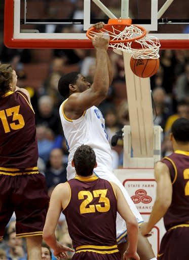 UCLA center Joshua Smith (34) dunks after getting by Arizona State center Jordan Bachynski (13) as teammate center Ruslan Pateev (23), of Russia, looks on during the first half of an NCAA college basketball game, Saturday, Jan. 7, 2012, in Anaheim, Calif. (AP Photo/Gus Ruelas)