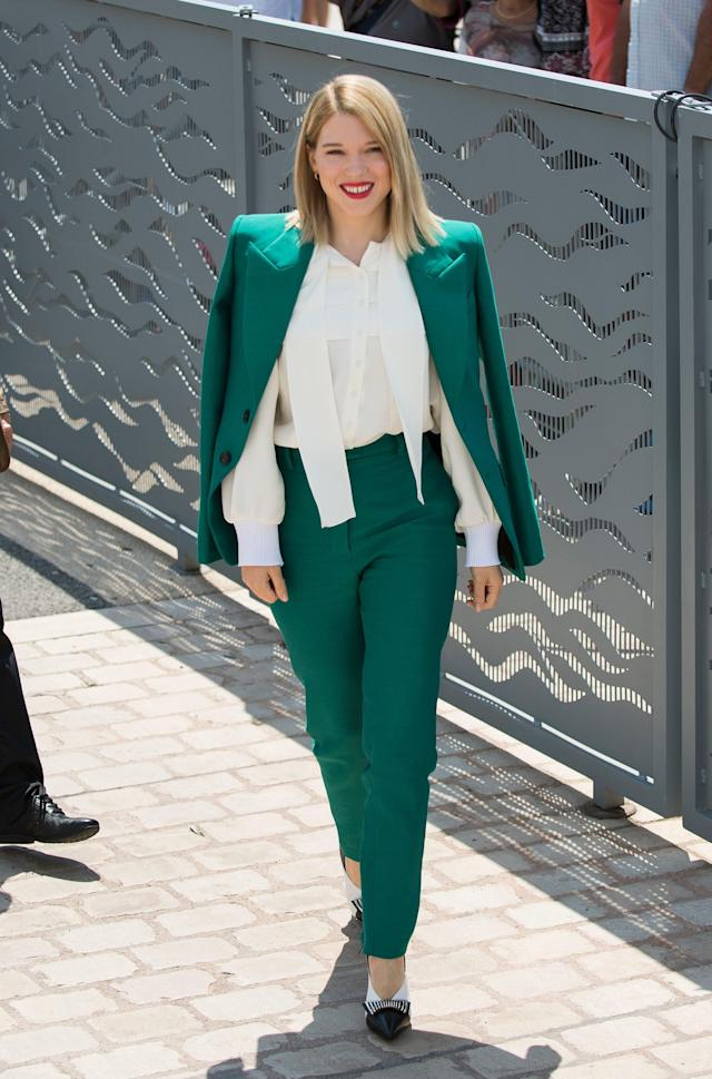 <p>Clad in a green Louis Vuitton trouser suit, the French star — and Cannes Film Festival jury member — looked as fashion-forward as ever. (Photo: Rex) </p>