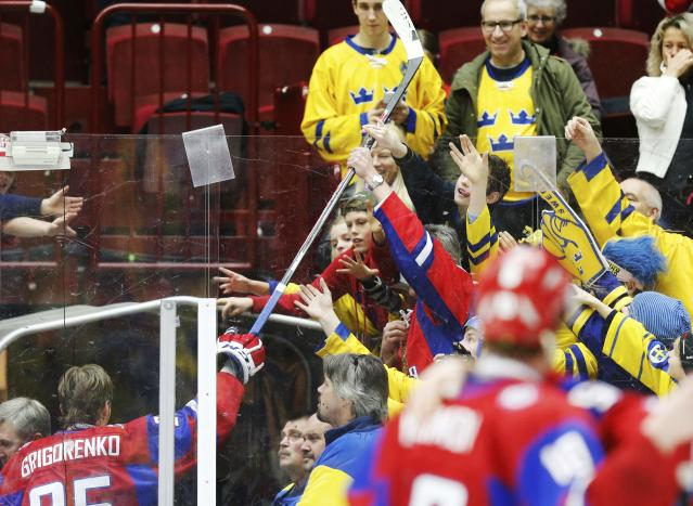 Russia's Mikhail Grigorenko hands his stick into the crowd after Russia defeated Canada following their IIHF World Junior Championship bronze medal ice hockey game in Malmo, Sweden, January 5, 2014. REUTERS/Alexander Demianchuk (SWEDEN - Tags: SPORT ICE HOCKEY)