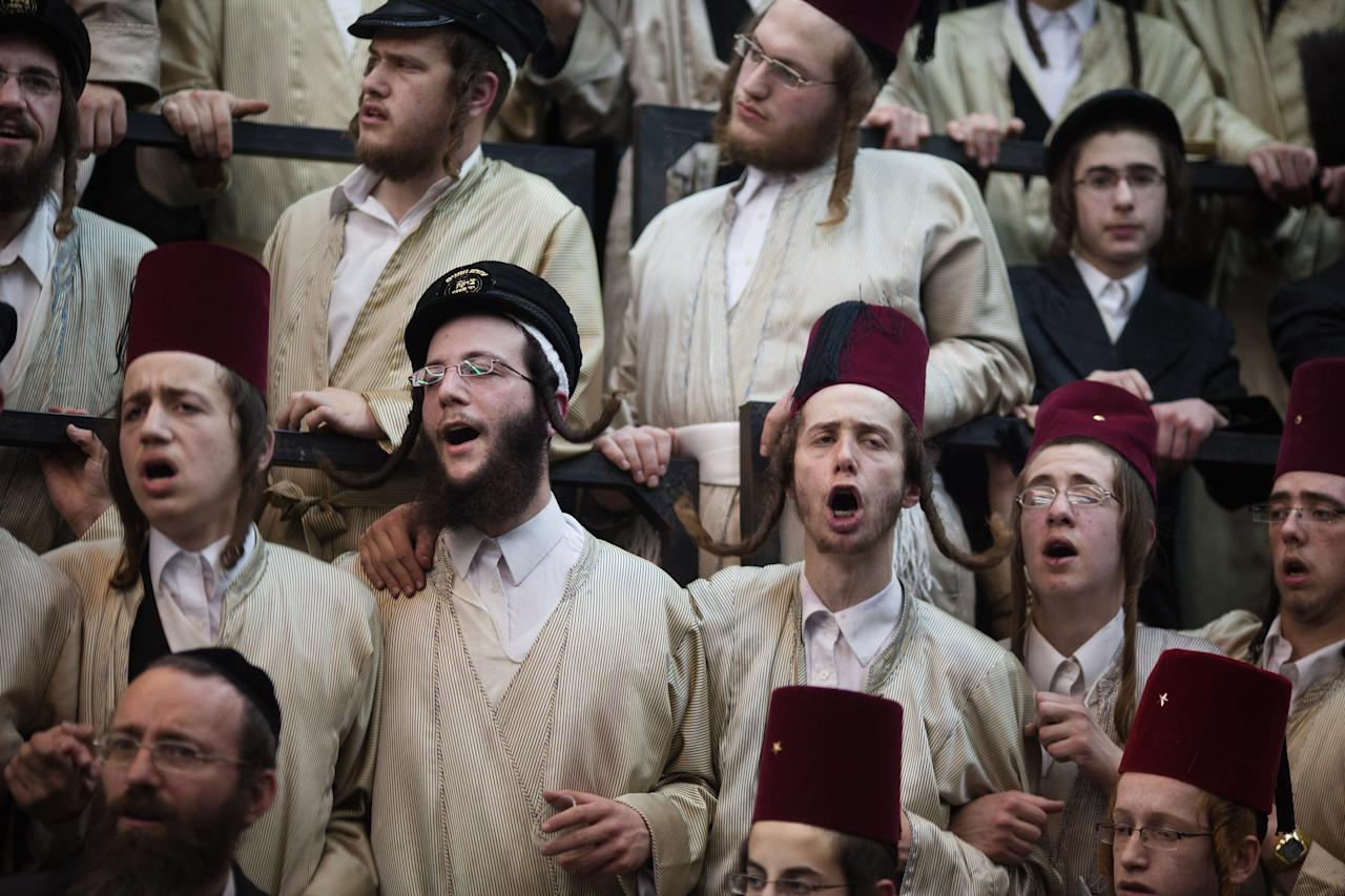 BEIT SHEMESH, ISRAEL - FEBRUARY 24: (ISRAEL OUT)  Ultra-Orthodox Jews from the Lelov Hasidic sect, celebrate the Jewish festival of Purim on February 24, 2013 in Beit Shemesh, Israel. The carnival-like Purim holiday is celebrated with parades and costume parties to commemorate the deliverance of the Jewish people from a plot to exterminate them in the ancient Persian empire 2,500 years ago, as described in the Book of Esther. (Photo by Uriel Sinai/Getty Images)