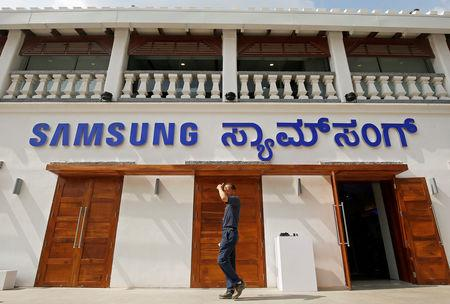 A man walks past a newly opened Samsung store in Bengaluru, India, September 11, 2018. REUTERS/Abhishek N. Chinnappa