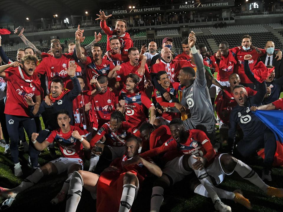 Lille players and staff celebrate their title triumph (AFP via Getty Images)