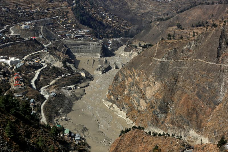 An aerial view shows a damaged barrage after a flash flood swept a mountain valley destroying dams and bridges, in Tapovan
