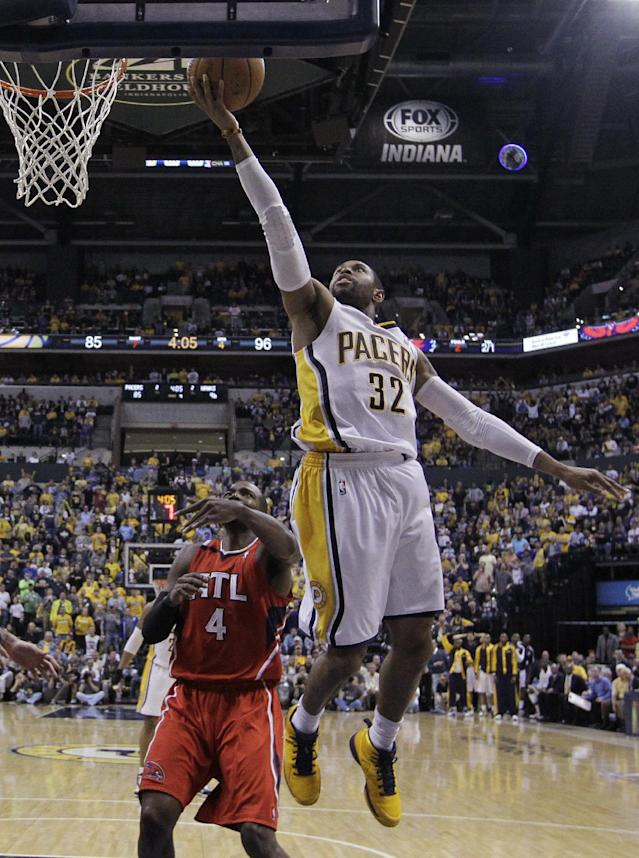 Indiana Pacers' C.J. Watson (32) puts up a shot against Atlanta Hawks' Paul Millsap (4) during the second half in Game 5 of an opening-round NBA basketball playoff series Monday, April 28, 2014, in Indianapolis. Atlanta defeated Indiana 107-97. (AP Photo/Darron Cummings)
