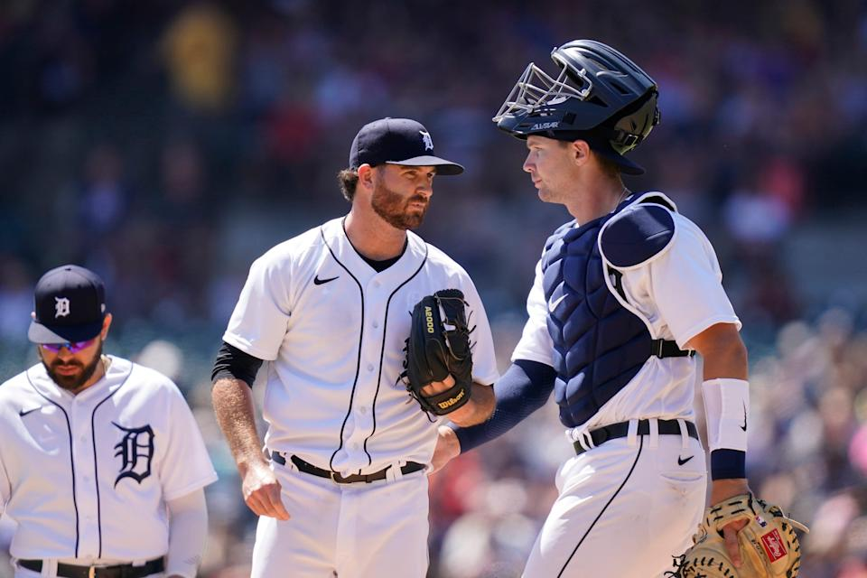 Detroit Tigers catcher Grayson Greiner pats starting pitcher Drew Hutchison before Hutchison is relieved during the second inning of a baseball game against the Cleveland Indians, Sunday, Aug. 15, 2021, in Detroit. (AP Photo/Carlos Osorio)
