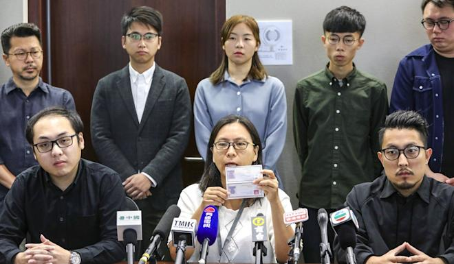 Beaten candidates (front row, from left) Lee Kan-ming, Lucia Chiu, and Law Ting-fai, announce their intention to challenge the results of the district council elections. Photo: May Tse